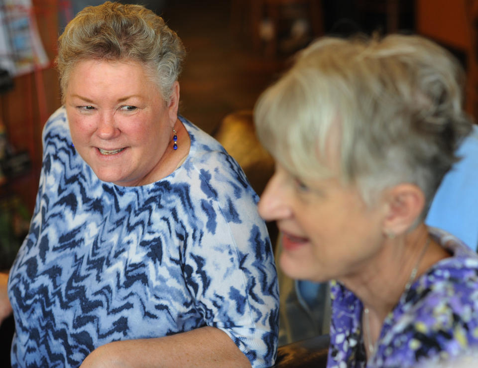 "Sally Ring, left, chats with Dian ""CJ"" Corneliussen-James, president of METAvivor."