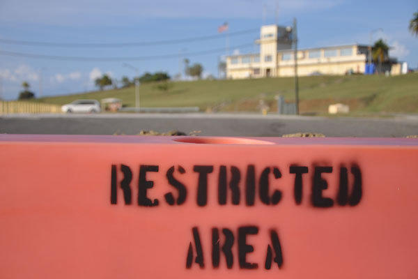A restricted area sign is posted in front of a war crimes courtroom at Camp Justice at the U.S. naval base at Guantanamo Bay, Cuba.