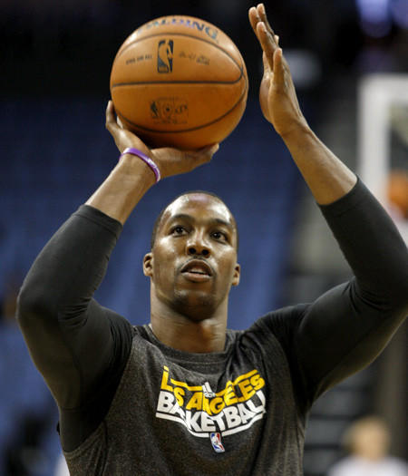 Lakers center Dwight Howard works out before a preseason game last week in Ontario.