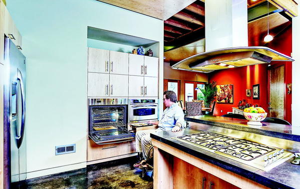 An accessible home kitchen should have work spaces at different heights in order to be suitable for all ages and abilities.