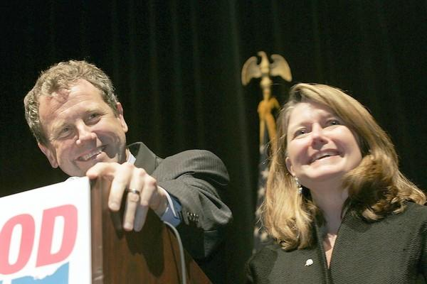 Ohio Democratic Senator-elect Sherrod Brown (L) gives his victory speech with his wife Connie Schultz (R) and his family, friends and staff at the Public Auditorium in the Convention Center on November 7, 2006 in Cleveland, Ohio.