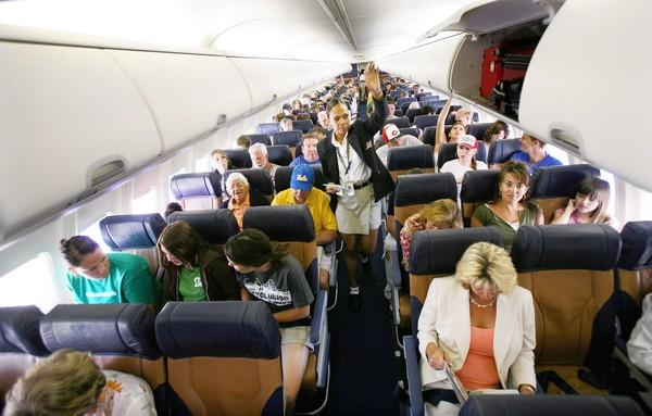 Southwest Airlines passengers await takeoff in 2006. In recent years, many airlines have been making their economy seats narrower and reducing leg room. Some Southwest seats are now about 17 inches wide.