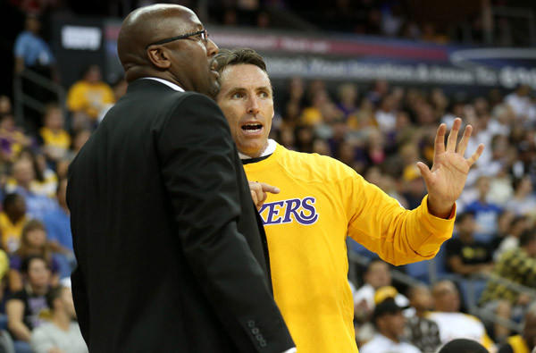 Lakers Coach Mike Brown and point guard Steve Nash discuss strategy during a break in an exhibition game.