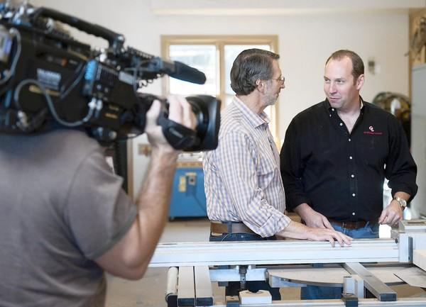 Norm Abram (left) and Grothouse Lumber owner Paul Grothouse Jr. collaborate on a project for 'This Old House.'