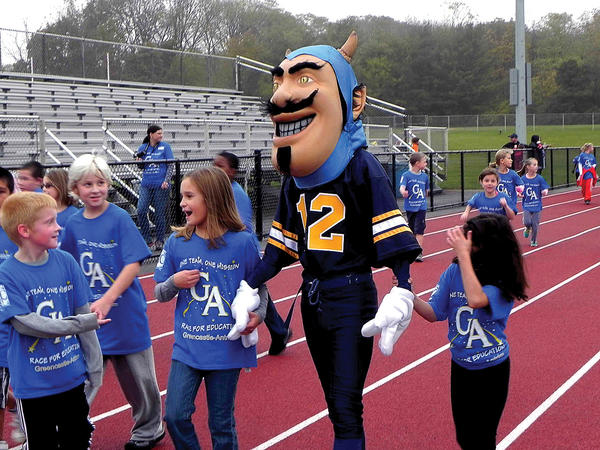 """Blue,"" Greencastle-Antrim Blue Devil's mascot, kept the energy high as third-graders walked, jogged and ran around the track around Kaley Field during the Race for Education on Friday which helped raise more than $70,000 to benefit the Greencastle-Antrim Elementary and Primary School PTO."