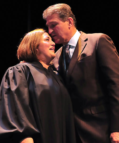 New U.S. district court judge Gina M. Groh gets a good luck kiss on the head Friday from Sen. Joe Manchin, D-W.Va. after an investiture ceremony at Shepherd University. Manchin and Sen. Jay Rockefeller, D-W.Va., nominated Groh for the position.