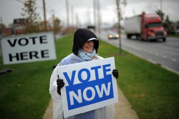 An Ohio Democratic Party volunteer braves the elements this week outside an early voting center in Columbus, Ohio.