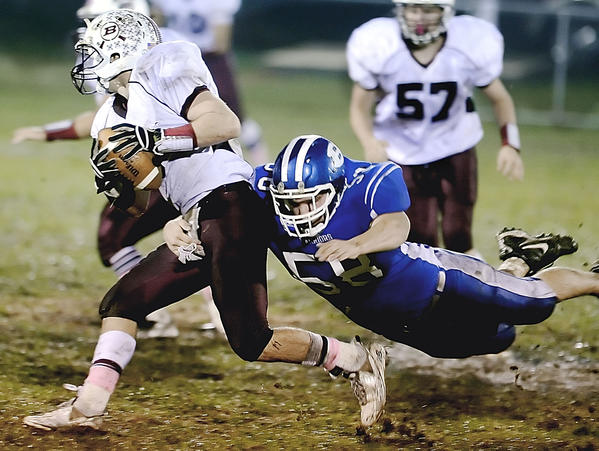 Boonsboro's Gerick Allen gets a hold of Brunswick quarterback Colin Nusbaum and drops him for a loss in the second quarter of Friday night's MVAL Antietam football game.