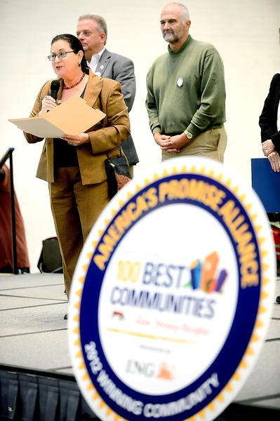 Former Washington County Public Schools Superintendent Elizabeth Morgan, left, talked about the 100 Best Communities For Young People award given to Washington County Friday night at at Valley Mall in Halfway. Standing behind her are Washington County Commissioner Jeffrey Cline and Washington County Board of Education President Wayne Ridenour.