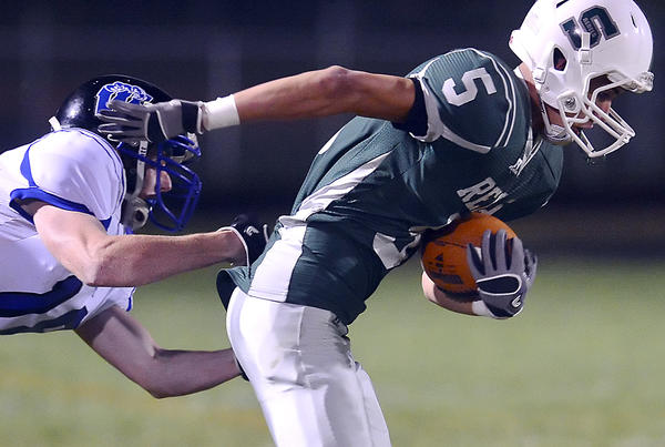 South Hagerstown's Willie Rivas breaks a tackle by Williamsport's Jesse Zeger during Friday night's MVAL Antietam football game at School Stadium.