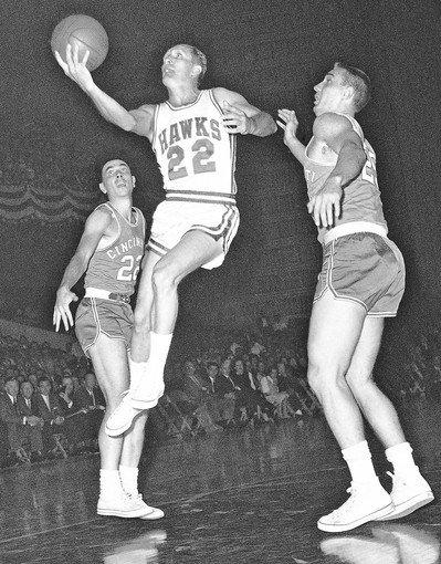St. Louis Hawk Slater Martin (22) leaps to make a basket in an NBA game against the Cincinnati Royals in 1959.