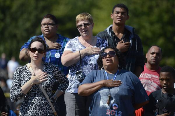 President Obama supporters say the Pledge of Allegiance prior to at a campaign rally in Woodbridge, Va.