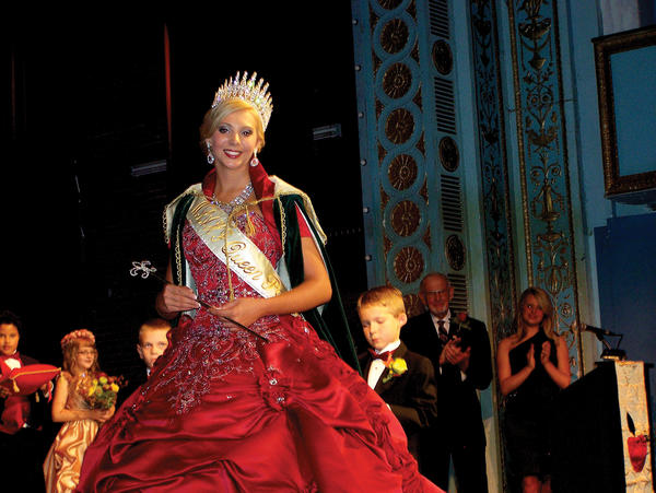 Alivia Lauren Ayers, 17, of Martinsburg, W.Va., presides as Queen Pomona XXXIII of the Mountain State Apple Harvest Festival on Friday night at Apollo Civic Theatre in Martinsburg after being coronated by West Virginia Commissioner of Agriculture Gus Douglass.
