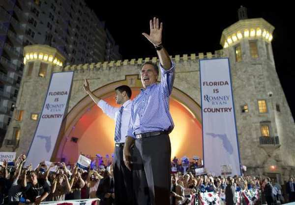 Republican presidential candidate Mitt Romney, right, and his running mate, Paul D. Ryan, rally supporters Friday night in Daytona Beach, Fla.
