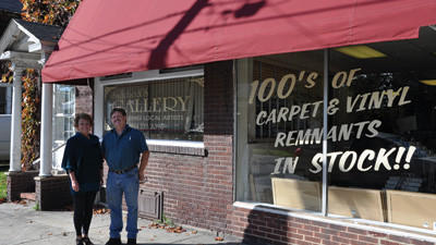Beckie Pender stands outside the Carpet Outlet with owner Jeff Coleman, who let her use space in his showroom for a new art gallery. Sadiebeck's Gallery displays the work of artists from Somerset County.
