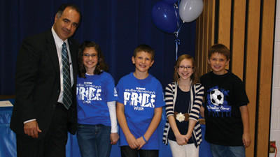 Jim Penna, district director for U.S. Rep. Mark Critz, D-Johnstown, poses with fifth-grade Windber students Riley Hanley, Jacob Manotti, Baylee Wojcik and Jacob Steinbeck. Windber is one of only eight schools in Pennsylvania to be recognized as a 2012 National Blue Ribbon School.