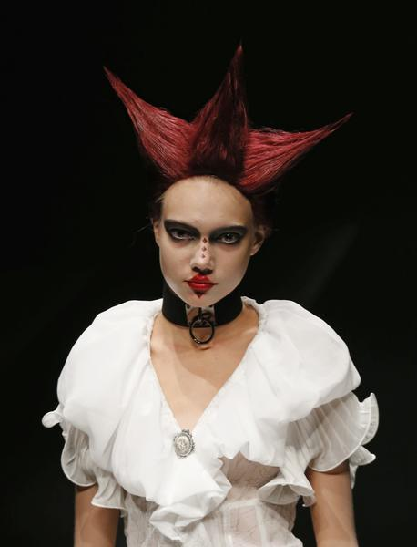 "A model displays a creation from designer Yasutaka Funakoshi's Japanese fashion brand ""Alice Auaa"" at the ""Alice In Wonderland In Me"" Fashion Show in Tokyo October 19, 2012"