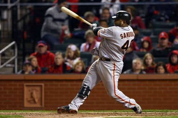 Pablo Sandoval #48 of the San Francisco Giants hits a solo home run in the eighth inning against the St. Louis Cardinals