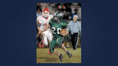 North Star's Shawn Costas beats Rockwood defenders to gain over 20 yards on this play late in the second quarter.