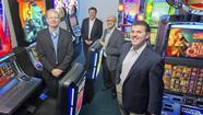 While Illinois officials remain mired in debate over all forms of gambling, WMS Industries is predicting that casinos will soon become ubiquitous — via<strong> </strong>your computer and cellphone, at least.