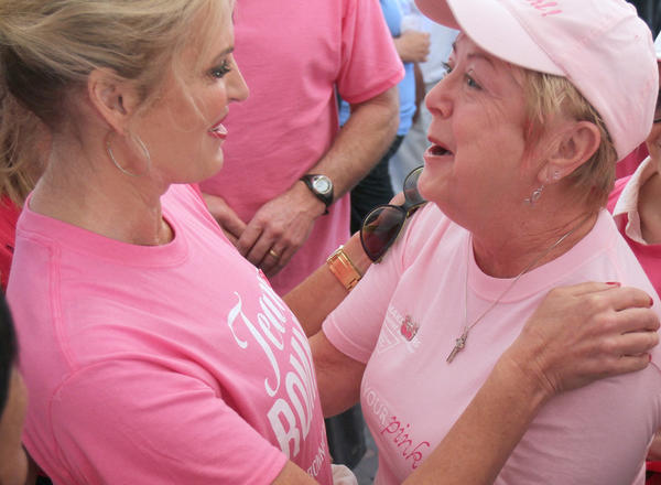 Ann Romney, left, wife of the 2012 Republican presedential nominee, Mitt Romeny, hugs cancer survivor Mary Moyer of Clermont, Fla. during the Making Strides Against Breast Cancer 5k in Orlando, Fla.