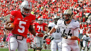 COLUMBUS, Ohio -- Kenny Guiton took over for an injured Braxton Miller and led Ohio State to a tying touchdown and two-point conversion with only three seconds to play in regulation before Carlos Hyde scored in overtime, as the seventh-ranked Buckeyes remained unbeaten with a 29-22 victory over Purdue.