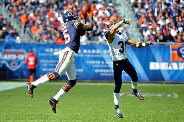 Wide receiver Brandon Marshall makes a catch over Rams cornerback Cortland Finnegan during the second half at Soldier Field.