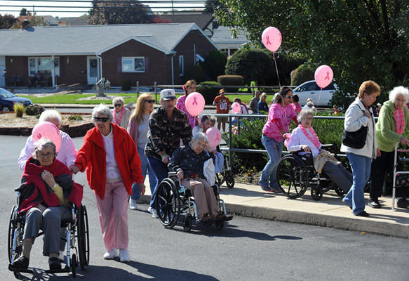 Residents, families and friends participate during a Breast Cancer Awareness day at Whitehall Manor Assisted Living located in Whitehall. Some of the activities included a 0.5k walk, pinning pink bow ties to a planted tree, and a bazar that included pink cupcakes , knitted dish clothes and other pink items for sale on Saturday afternoon. All the monies raised will be donated to be used to purchase wigs for those with cancer and in chemo therapy according to activities director Alexis Stengel.