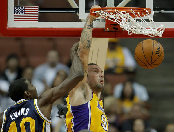Lakers forward Reeves Nelson dunks against Jazz forward Jeremy Evans in an exhibition game Tuesday.