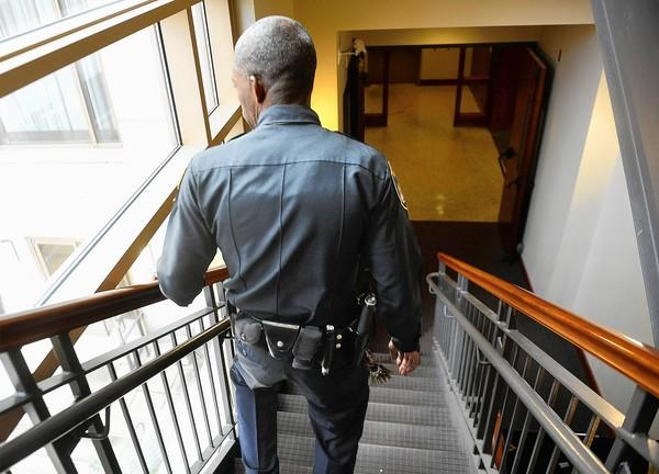 An Enoch Pratt Free Library officer walks through the building. The library is one of several respected city institutions to use special police.