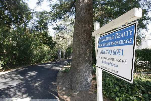 A home for sale in La Canada Flintridge on Friday. Prices are lower than they were one year ago, according to one agent.