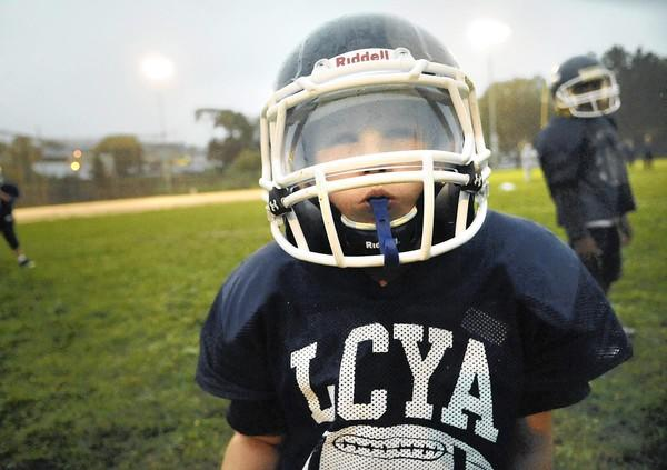 Gage Dannecker, 10, of Allentown, center, is blind, but plays football for LCYA Bulldogs nevertheless.