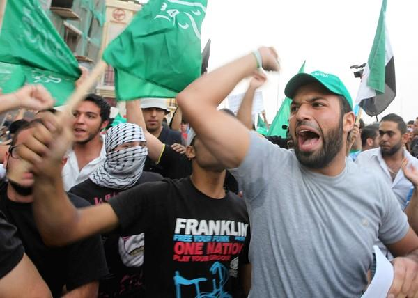 Demonstrators chant slogans Oct. 20 in Martyrs Square in Beirut to protest the killing of Lebanon's intelligence chief, Gen. Wissam Hassan and seven others.