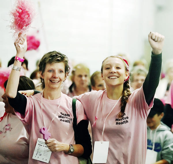"Debbie Eich, left, and her daughter, Abbey Eich, let out a cheer while taking the ""victory"" lap for breast cancer survivors at Step 'n Stride, Breast Cancer Awareness-Cumberland Valley's largest annual fundraiser. Debbie Eich from Greencastle, Pa., is a breast cancer survivor."