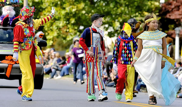 Clowns parade down King Street Saturday during the Mountain State Apple Harvest Festival parade in Martinsburg, W.Va.