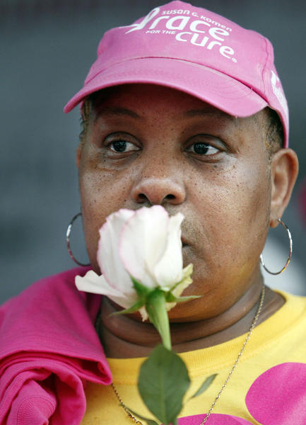 Tanya Smith, an eight-month breast cancer survivor from Miami, is momentarily somber during the Survivor Ceremony of the Susan G. Komen Race for the Cure.