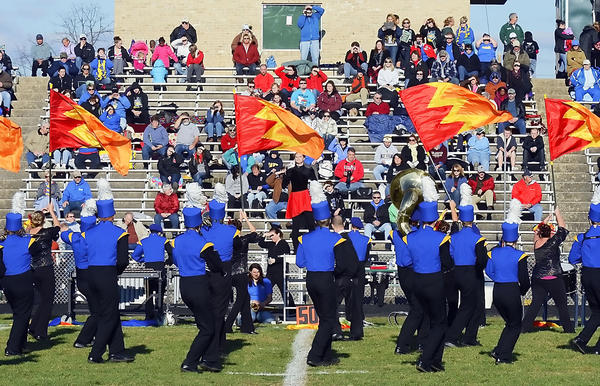 The Northern Garrett Marching Band performs for the crowd and judges at the Tournament of Bands Chapter V Championships at School Stadium on Saturday.