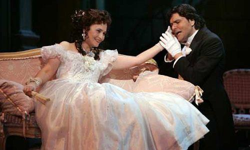 "Marina Poplavskaya as Violetta Valery and Massimo Giordano as Alfredo Germont in ""La Traviata."""
