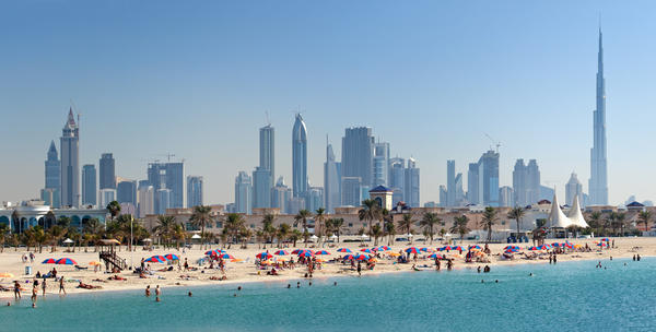 Spurred by oil revenues, Dubai's growth has accelerated rapidly in the past 15 years and its skyline reflects that. Its numerous tall and slender buildings - many of which were completed in just the past five years - look from a distance like man-made stalagmites jutting up from the desert floor. Buildings like the Burj Khalifa (by far the tallest building in the world) and the Burj al Arab (built on its own artificial island) combine state-of-the-art modern architecture with design cues pulled from nature and Islamic heritage, helping to give Dubai's skyline its distinctive visage.