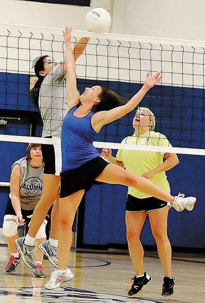Nancy Dean, a 1992 graduate, and 1995 graduate Lynde (Tritsch) Senuta battle at the net during the 90s game at Saturday's Williamsport Alumni Volleyball event.
