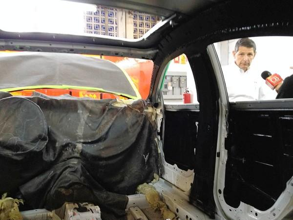 Jose Eduardo Llanos, a Global Armor executive, shows a car with its interior stripped in preparation for installation of a high-end protection package at the company's plant in Ecatepec, Mexico.