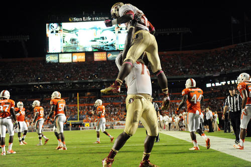 James Wilder Jr. of FSU celebrates a touchdown with teammate Cameron Irving that tied the game at 10-10 in the second quarter against UM. Sun Life Stadium, Miami Gardens, FL.
