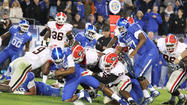 LEXINGTON, Ky. (AP) - As Aaron Murray was told about his record-breaking numbers, the only ones that mattered to him Saturday night were on the scoreboard.