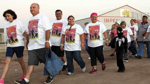 Cancer survivors and supporters walk around the field during a Community Campout by the Cancer Resource Center of the Desert on Saturday at Imperial High School.