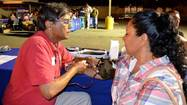 Physical therapist Shyam Ullal checks Marta Nunez's blood pressure.