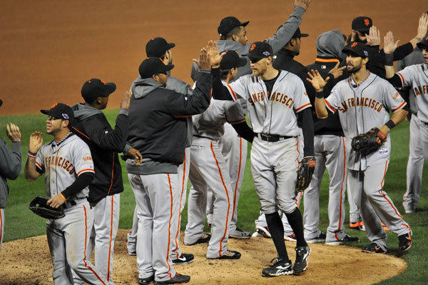 San Francisco Giants right fielder Hunter Pence (center) celebrates with teammates after winning game five of the 2012 NLCS against the St. Louis Cardinals at Busch Stadium.