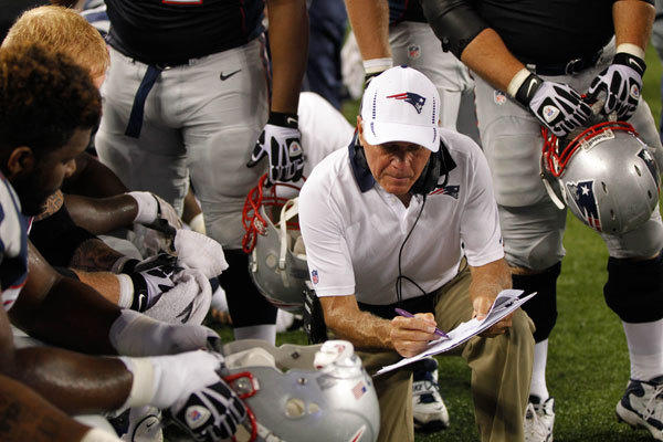 New England Patriots offensive line coach Dante Scarnecchia talks with the offensive line during the fourth quarter against the New Orleans Saints.