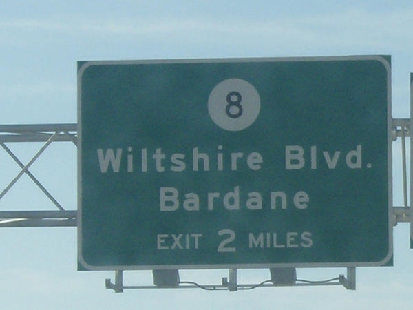 "This sign on W.Va. 9 in Jefferson County lists ""Wiltshire Blvd."" for an approaching exit, but the correct name is ""Wiltshire Road."" The West Virginia Department of Transportation plans to replace the sign."