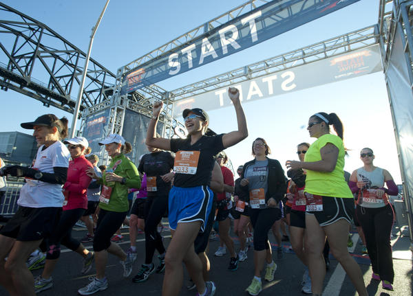 Runners sprint from the starting line of the Runner's World Half Marathon on Daly Ave in south Bethlehem on Sunday. The 13.1-mile course wound through Bethlehem¿s historic neighborhoods, Lehigh University and Moravian College), and the former Bethlehem Steel complex.