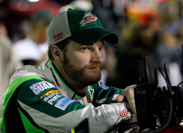 Dale Earnhardt Jr. leans on his number 88 Chevrolet before starting in the rain delayed NASCAR Sprint Cup Series Daytona 500 race at the Daytona International Speedway in Daytona Beach, Florida, February 27, 2012.